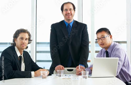 Group Of Businessmen Meeting In Office
