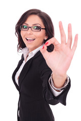 business woman shows ok sign