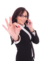 business woman on phone, ok sign