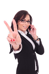 business woman victory sign & phone