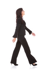 business woman walks to side