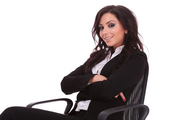business woman sits on chair
