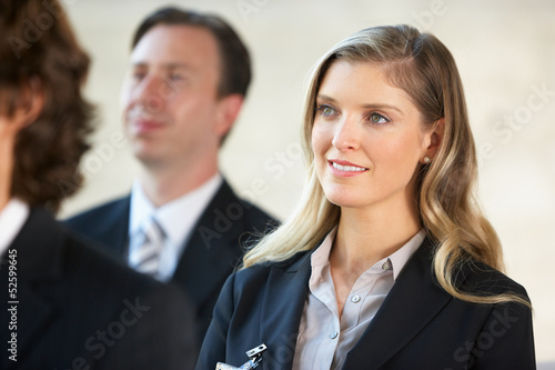 Businesswoman Listening To Speaker At Conference
