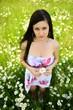 Beautiful Young Woman Outdoors. Enjoy Daisy