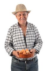 a farmer man holds a basket with eggs