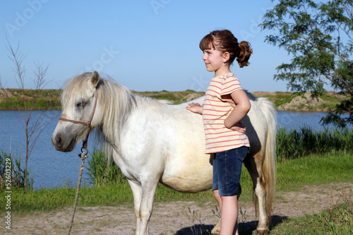 little girl and pony horse