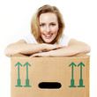 Pretty young woman rests on her moving box