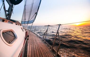 Sailing regatta in Greece, during sunset.