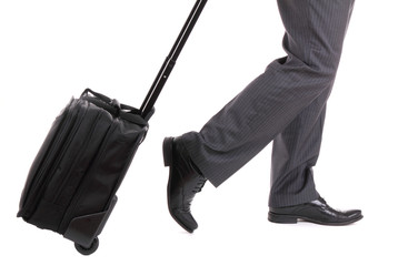 A business traveler with suitcase on white background