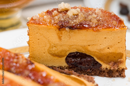 Macro of caramel cake with chocolate cream and caramelized sugar
