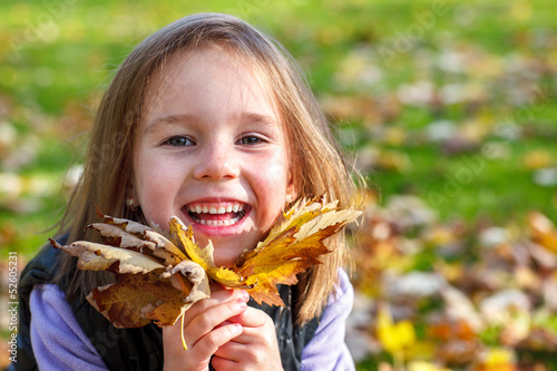 Happy autumn preschool girl