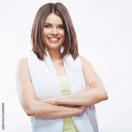 Smiling fitness girl holding towel isolated on white background