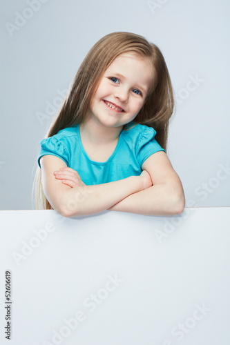 Kid girl isolated against gray background .