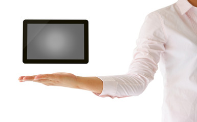 holding tablet computer in his hand on white background