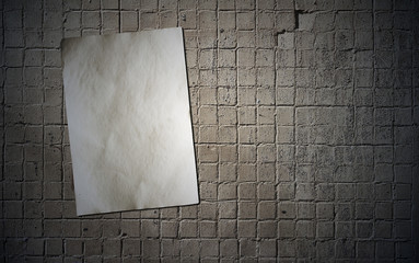 paper on tile wall