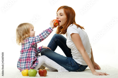 Mother and child with apples.