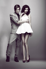 Passion. Fashion Couple in Trendy Clothes Hugging. Elegance