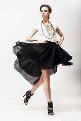 Vitality. Supermodel in Fluttering Fashion Dress. Oscillation