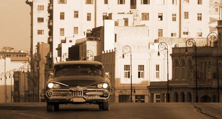 A classic car driving the Malecon, Havana, Cuba