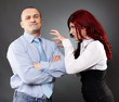 Businessman ignoring angry businesswoman