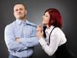 Businesswoman pulling businessman's necktie