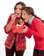 Mom and daughter eating popcorn