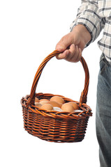 a farmer man holds a basket with eggs