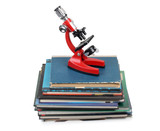 Microscope on book