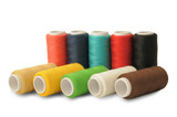 Spools of threads of different colors on white