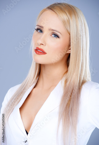 Casual and sexy blond woman isolated
