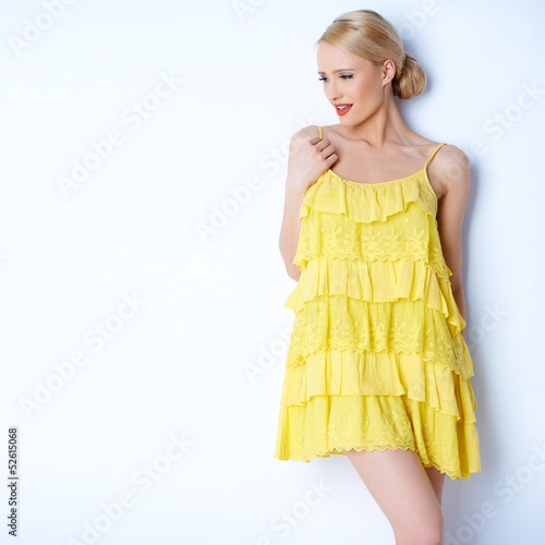 Pretty elegant woman wearing yellow dress