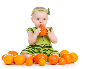 baby girl eating fruits isolated on white background