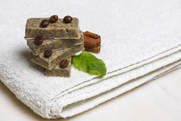 Homemade soap bars with coffee beans, cinnamon and lavender leaf