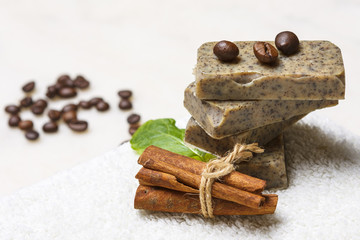 Handmade soap bars with coffee beans, cinnamon and lavender