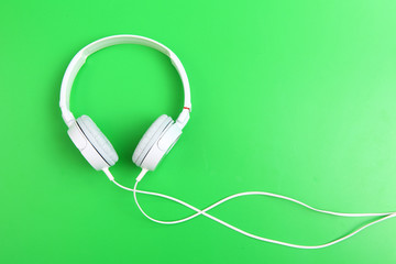Headphone on green background