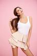 Cute brunette on pink