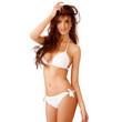 Sexy young woman in a white bikini