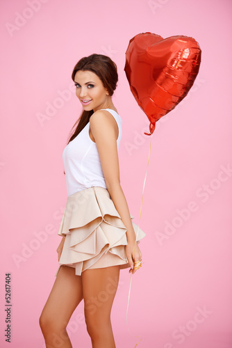 Cute brunette with red heart