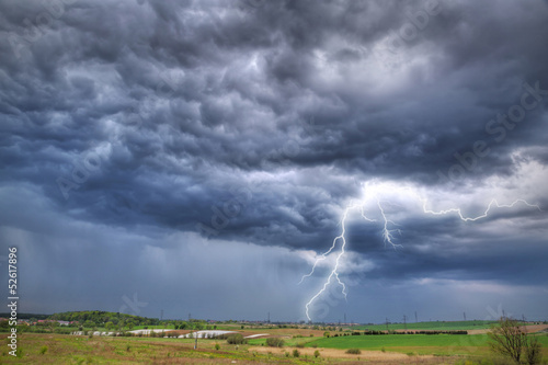Summer thunderstorm over the meadow in Poland
