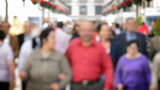 People walking down on the street defocused