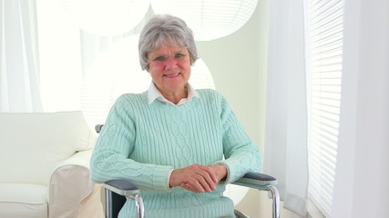 Mature Caucasian woman in a wheelchair