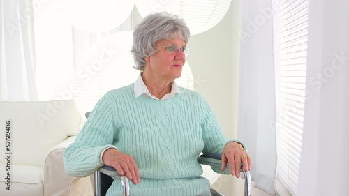 Mature Caucasian woman looking through window