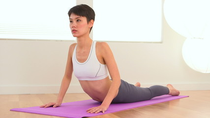 Chinese woman doing yoga