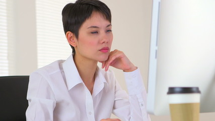 Chinese businesswoman thinking