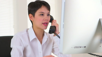 Chinese businesswoman talking on the phone