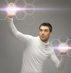 futuristic man working with virtual screens