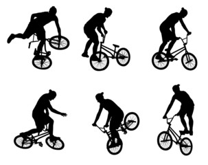 stunt bicyclist silhouettes - vector