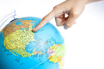 A Finger pointing to United States of America in a World Globe