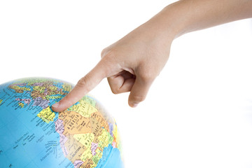 A Finger pointing to Spain in a World Globe