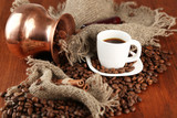 Fototapety Coffee pot and cup on brown wooden background